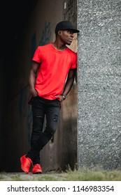 African man in red t-shirt at urban city place