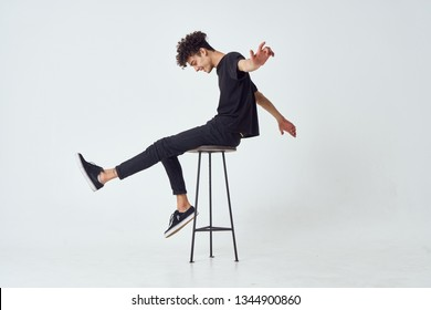 african man sitting on a studio chair