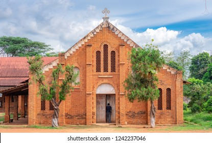 African Man stepping into the door of a little church at the Cathedral Bangui, Notre Dame, famous church in Central African Republic