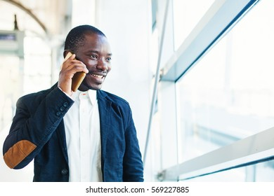 african man talking on mobile phone