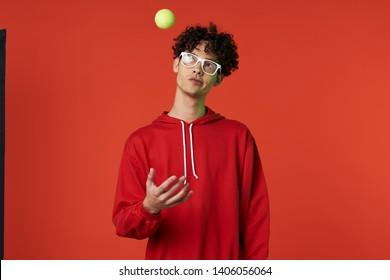 african man tennis ball in the air