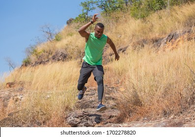 african man Trail running in Meadow on mountain outdoor. sport adventure . black man runner  jumping on country path or cross-country in summer . healthy lifestyle