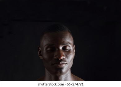African man wilth eyes closed