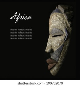 African mask over black background