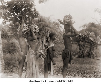 African men and woman arriving at the monthly wild rubber village market, carrying raw rubber in the then French colony of Moyen Congo (present Congo) in 1943.