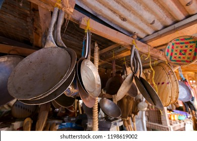 African Mitad, flat cooking pan to make flatbread and other cooking utensils at fresh market in Mto wa Mbu village, Arusha Region, Tanzania.