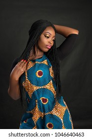 African Model on African printed dress posing for a shoot in the studio