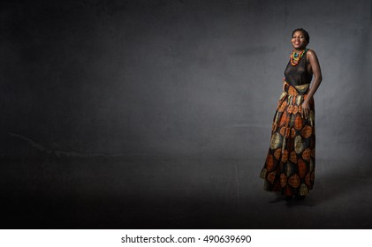 african model smiling , dark background