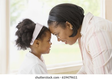 African mother and daughter looking at one another