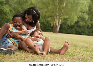 African mother and her kids are having fun in the nature