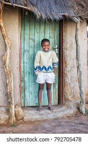african Motswana child sitting in the door of the shack