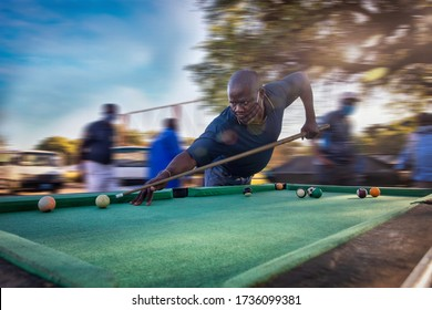 African people playing snooker at the bus rank in Gaborone, free time