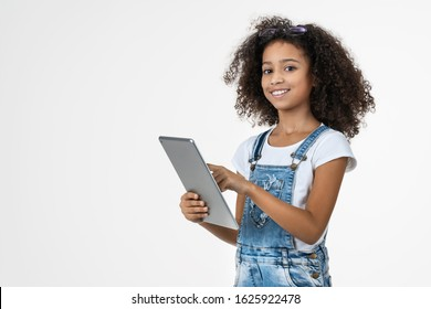 African preteen girl using tablet computer playing game isolated on white background