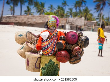 African saleswoman with baby on the back