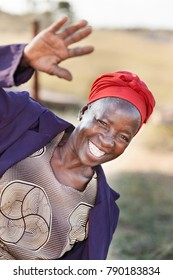 African senior citizen woman in her 70 with a happy face greeting everybody