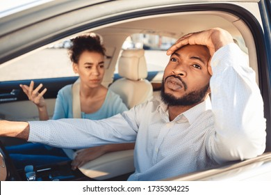 African Spouses Having Quarrel Sitting In Car During Summer Vacation. Family Problems Concept. Selective Focus