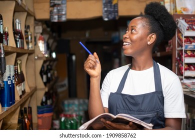 african store keeper taking stock of available products