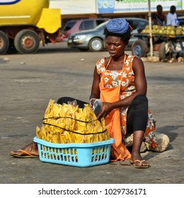 African street vendor sells local products. African woman. Ordinary life in African town. Lifestyle in developing countries. Street market in Ghana. Accra, Ghana - January 11, 2017