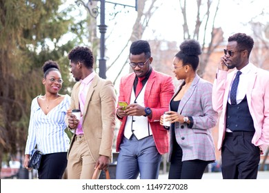 african students are making up a plan of a future business in the street. city life concept