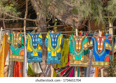 African styl shirts hanging at the street market for selling at Diani Beach, Kenya