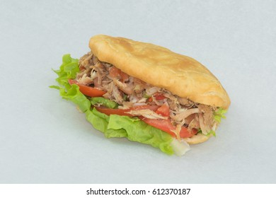 African style burger with tender chicken and salad