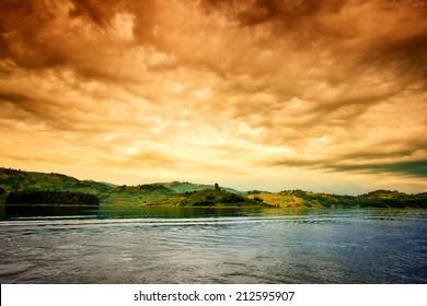 African sunset with stormy sky at Lake Bunyonyi in Uganda, Africa