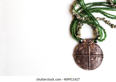 African traditional ethnic beads, natural stones jewelry necklace with metal buckle isolated on white background. Green tint. Modern fashion art tribal accessories.