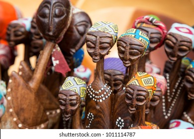 African tribal art for sale at a market stall.