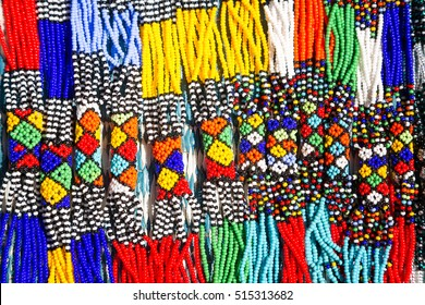 African tribal necklaces. Closeup of intricate bead work for sale at a street market.