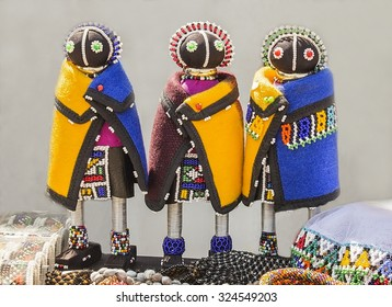 African unique rag dolls in traditional handmade colorful beads and fabrics clothes. Craftsmanship. African fashion.  Local craft market in South Africa. Ethnic costume of tribe Sesotho, Basotho.
