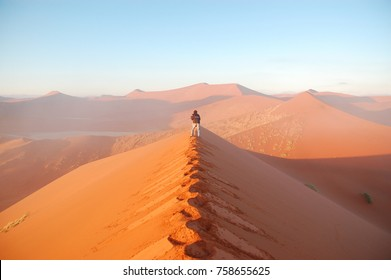 African vacation holaday, photographer making picture of Namib desert dunes and lanscape, Namibia, Africa