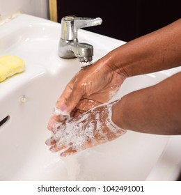 An African woman display how to do an hygiene hand wash