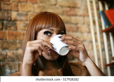 African woman drinking coffee and relaxing.