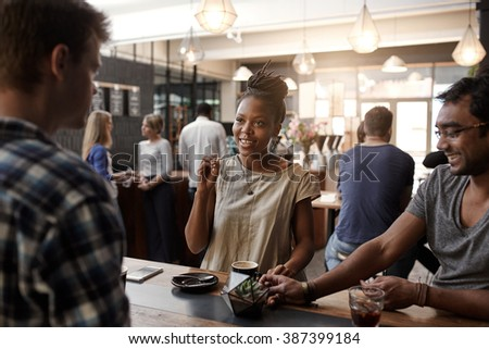 African woman entrepreneur having a meeting in coffee shop