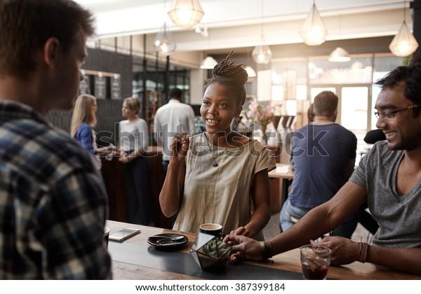 African woman entrepreneur having a meeting in coffee shop