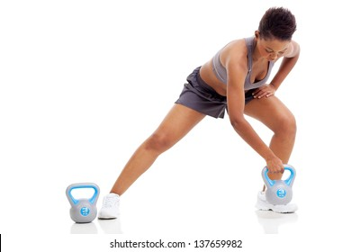 african woman exercising using kettle bell over white background