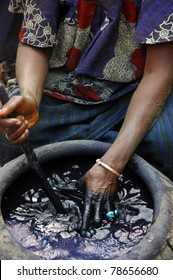 An African woman hand dying material indigo