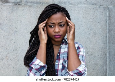 African woman with headache