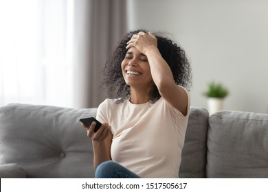 African woman laughs at funny video, prank online that friend sent, lucky moment celebrate lottery win, opportunity download new app, sales offer, check email received info about getting a job concept