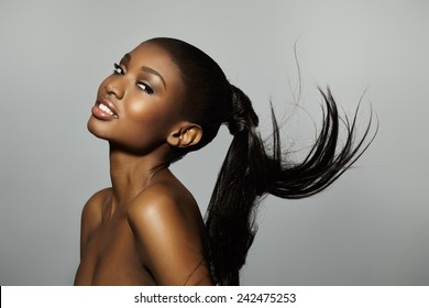 African woman with long tail floating.