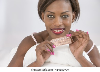 African woman presenting Contraceptive Pill