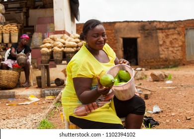 African woman selling fruits at the farmers market