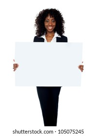 African woman showing billboard banner. Copy space concept