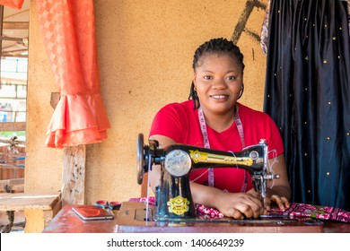 african woman tailor smiling while working
