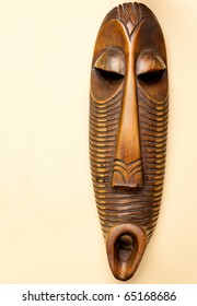 African Wooden Mask on Beige Background