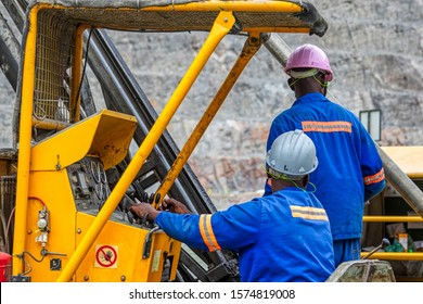 African workers operating a heavy duty machinery is  diamond mine in Jwaneng, Botswana