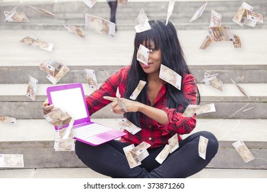 African young girl with laptop