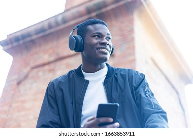 African Young Man Listening Music.