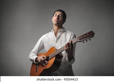 African young man playing the guitar