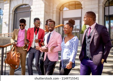 african youth gang.african friends sticking together. togetherness concept. side view photo. travelers from Africa going sightseeing